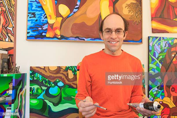 Portrait of an artist with aspergers in his studio