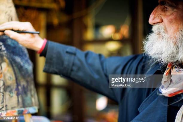 Portrait of an artistic painter in workshop