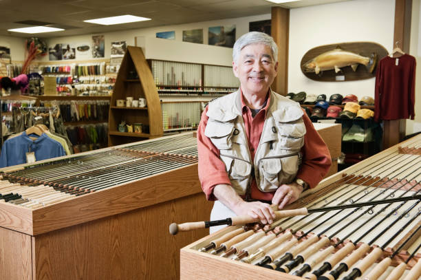 portrait of an asian american senior male owner of a retail fly shop picture