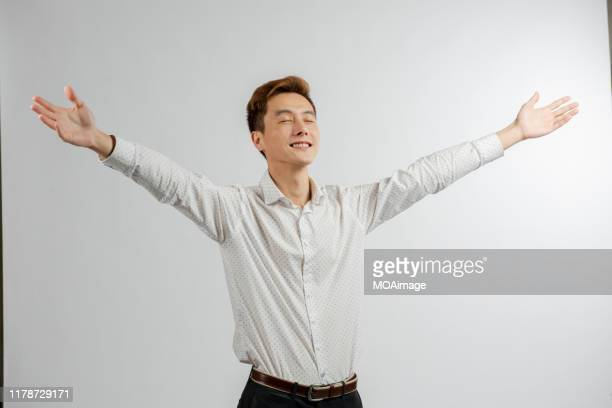 a portrait of an asian businessman in a white shirt in a studio - 白いシャツ ストックフォトと画像