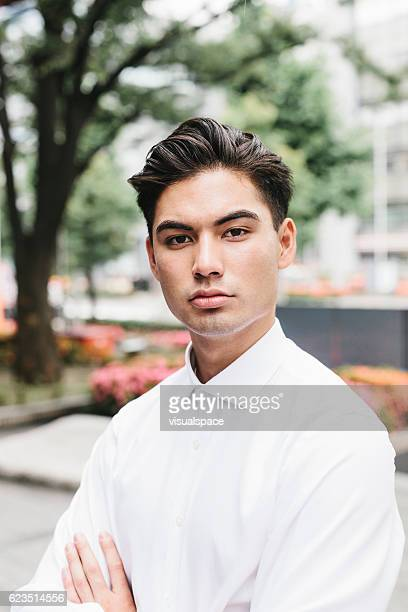 portrait of an asian businessman - lypsekyo16 stock pictures, royalty-free photos & images