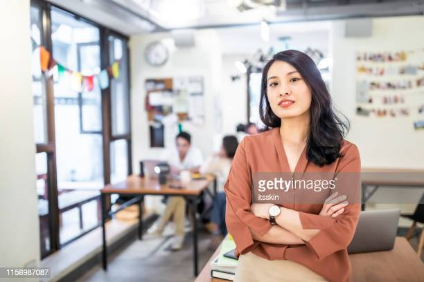 portrait of an asian businesswoman. - chinese culture stock pictures, royalty-free photos & images