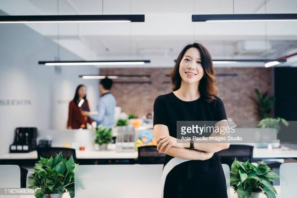 portrait of an asian businesswoman. - chinese ethnicity stock pictures, royalty-free photos & images