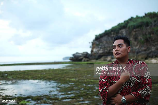 portrait of an asian man at the sea side - omar shamsuddin stock pictures, royalty-free photos & images