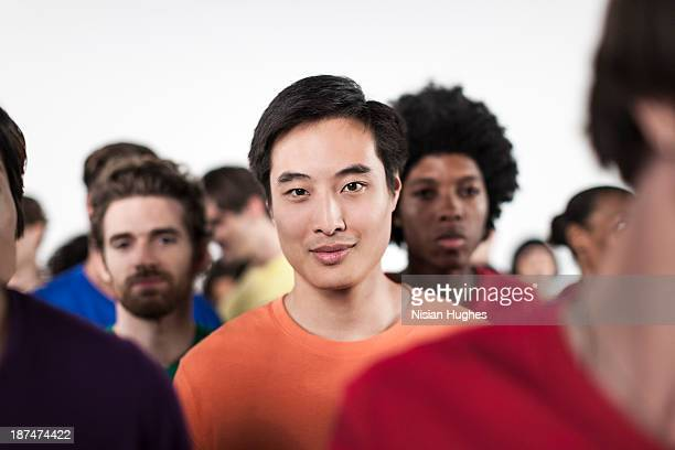 Portrait of an Asian Man in a Diverse Crowd