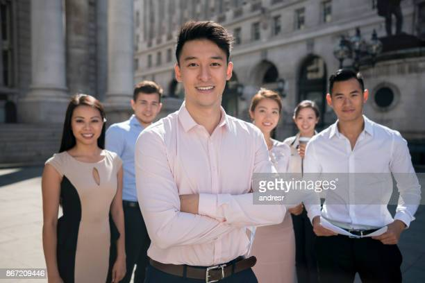 Portrait of an Asian man leading a business group