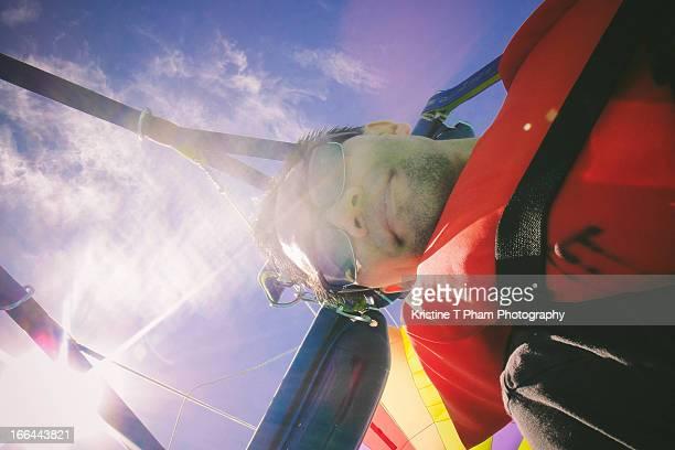 Portrait of an Asian man parasailing