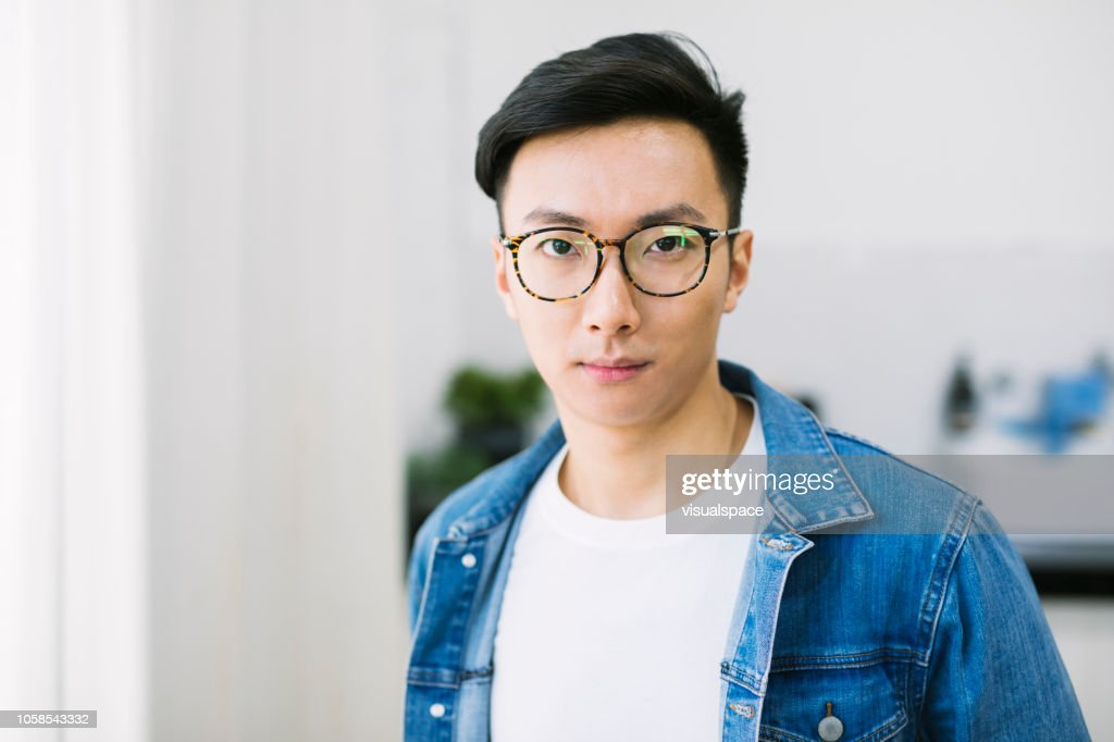 Portrait of an asian man with glasses. : Stock Photo
