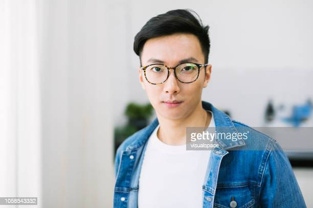 portrait of an asian man with glasses. - adults only stock pictures, royalty-free photos & images