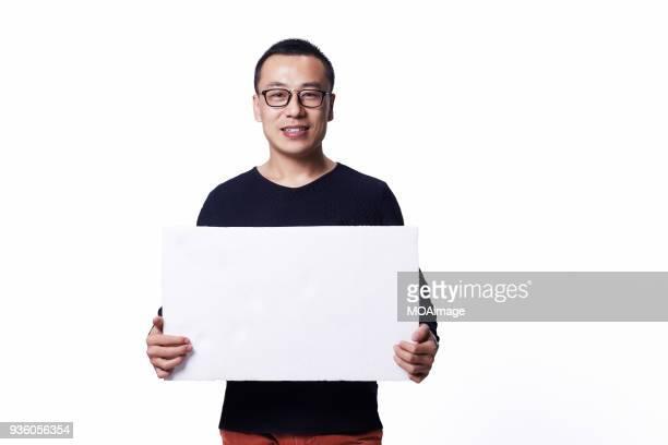 portrait of an asian middle-aged man - man holding paper imagens e fotografias de stock