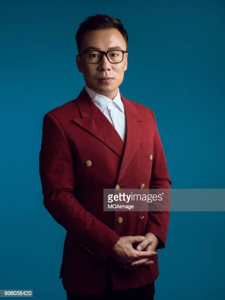 portrait of an asian middle-aged man - red suit stock pictures, royalty-free photos & images