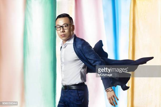 portrait of an asian middle-aged man - multi colored suit stock photos and pictures