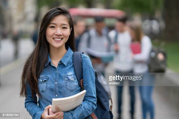 Portrait of an Asian student on the street looking at the camera smiling