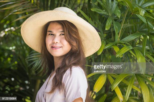 portrait of an asian transgender man with straw hat - transgender woman stock photos and pictures
