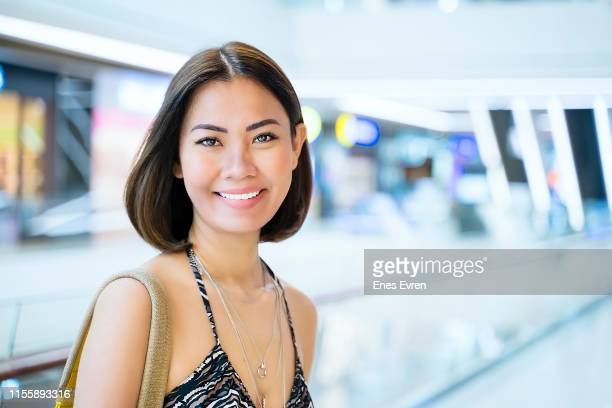 Portrait of an Asian woman looking at camera in shopping mall