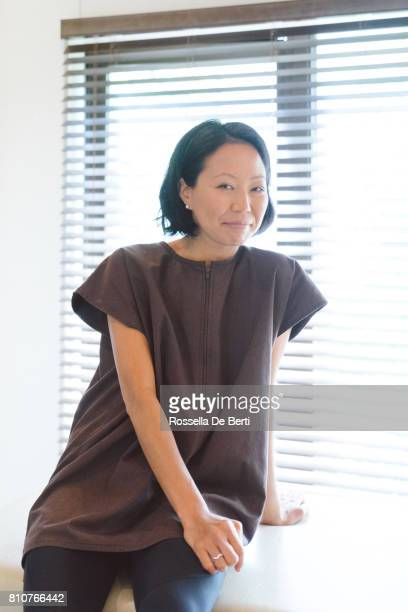 Portrait of an asian woman on examination table in medical office