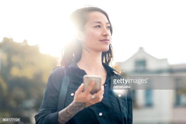 Portrait of an Asian woman using smart phone