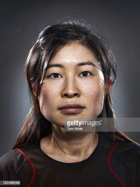 portrait of an asian woman with sweaty brow - passione foto e immagini stock