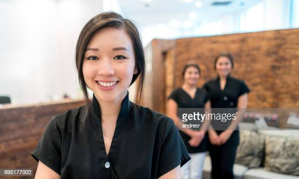 Portrait of an Asian woman working at a spa