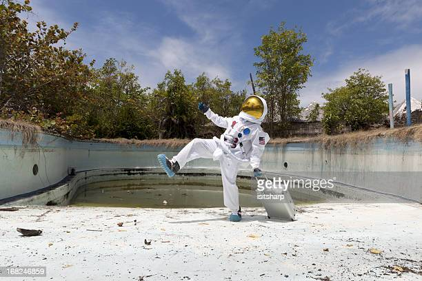 Portrait of an astronaut in empty swimming pool.