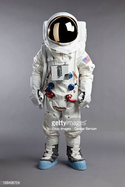a portrait of an astronaut, studio shot - astronaut stock-fotos und bilder