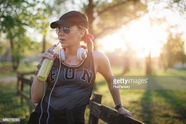 Portrait of an athlete girl listening to music in the park
