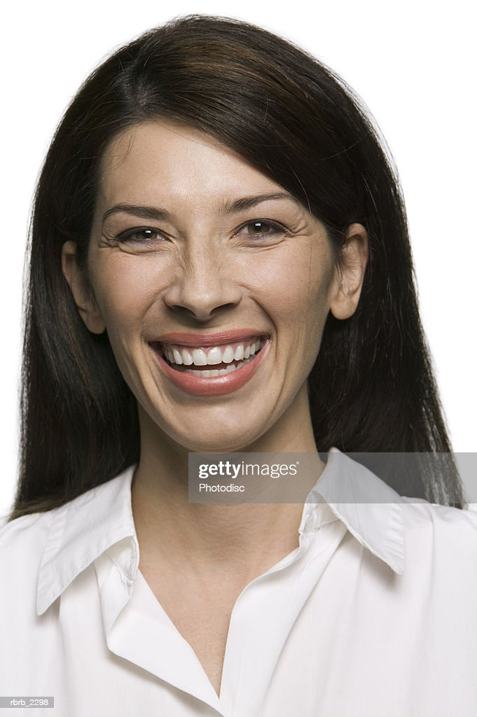 portrait of an attractive adult brunette woman as she smiles brightly at the camera : Stock Photo
