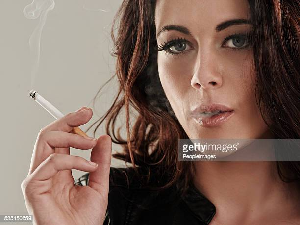 she's a bad girl by nature - beautiful women smoking cigarettes stock photos and pictures