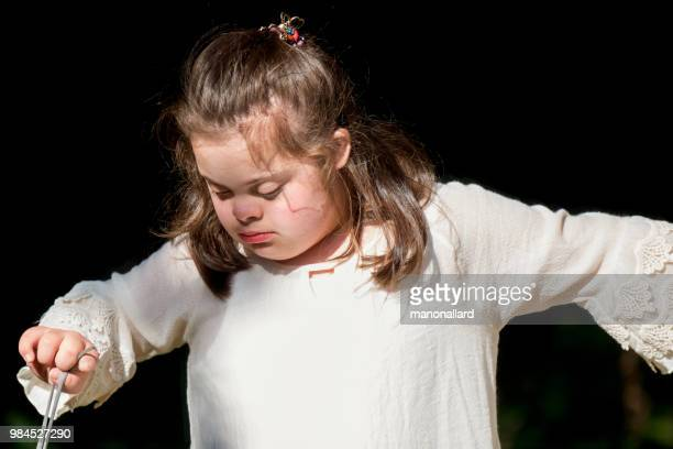 portrait of an authentic girl of 12 years old with autism and down syndrome in daily lives - bottomless girls stock pictures, royalty-free photos & images