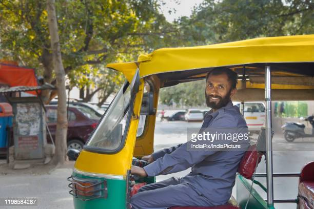 portrait of an auto driver - auto rickshaw stock pictures, royalty-free photos & images