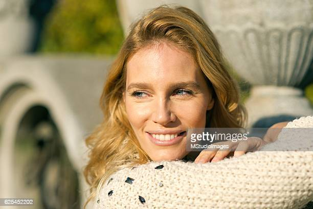 Portrait of an beautiful blondy smiling woman looking away