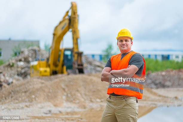 Portrait of an Earth Digger Driver with blueprint in hand