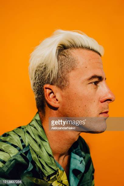 portrait of an eclectic young man - bleached hair stock pictures, royalty-free photos & images