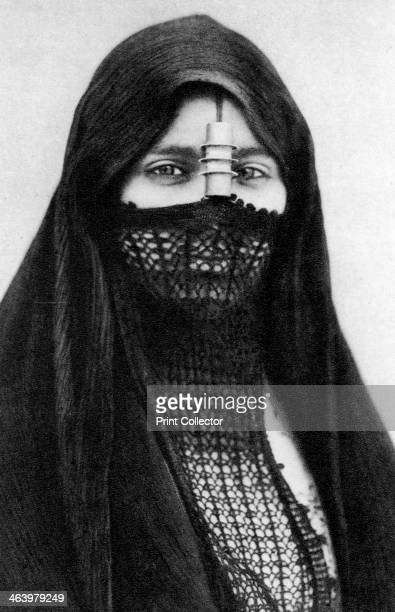 A portrait of an Egyptian woman c1920s Plate taken From In the Land of the Pharaohs published by Lehnert Landrock