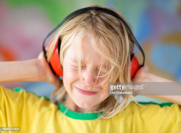 Portrait of an eightyearold boy with red ear protections on August 05 in Sankt Augustin Germany Photo by Ute Grabowsky/Photothek via Getty Images