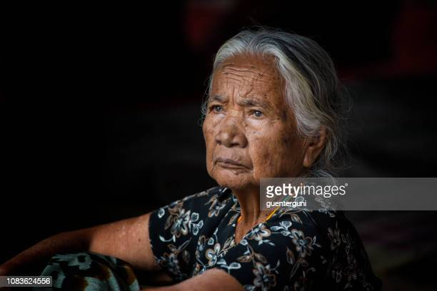 portrait of an elder women of the toraja tribe, sulawesi, indonesia - rantepao stock photos and pictures