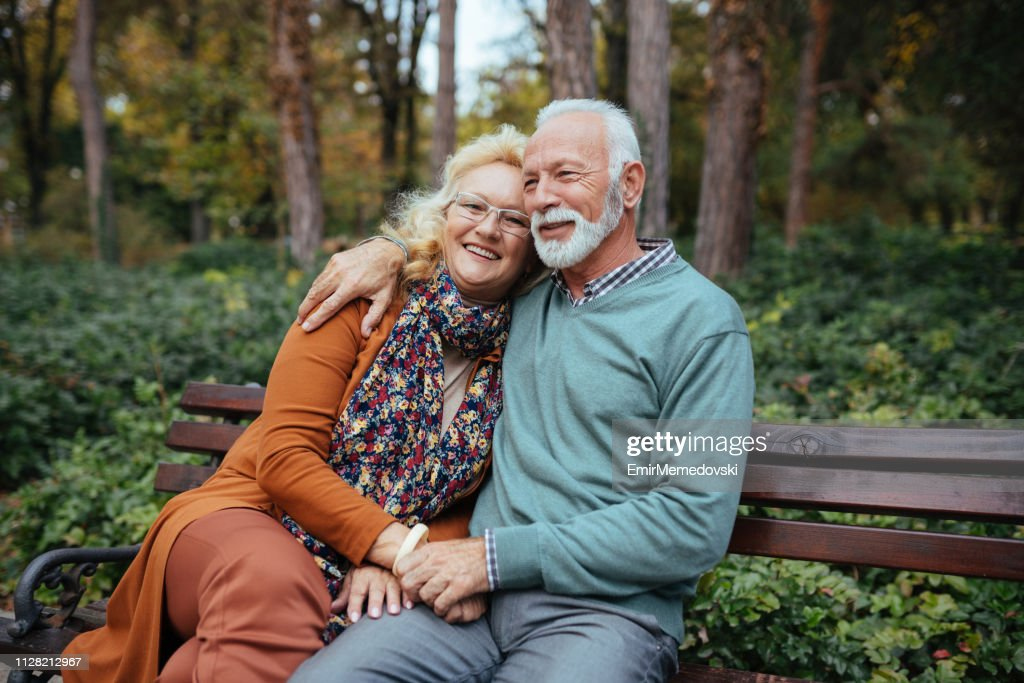 Portrait of an elderly couple in the park : Stock Photo