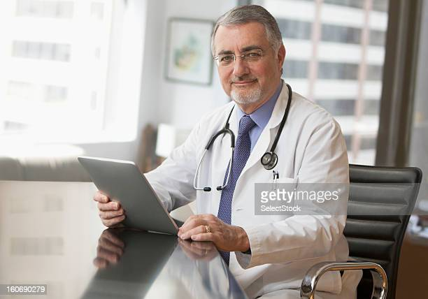 portrait of an elderly doctor - goatee stock pictures, royalty-free photos & images