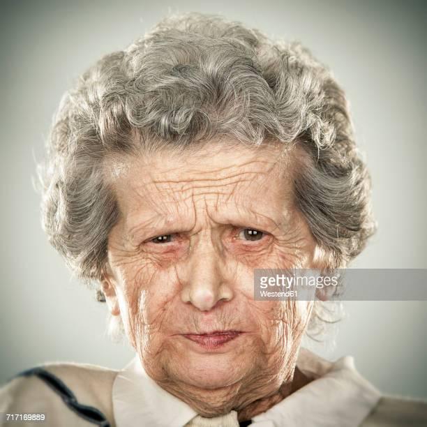 portrait of an elderly lady - grimassen stockfoto's en -beelden