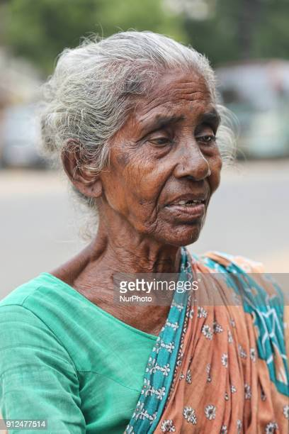 Portrait of an elderly Tamil Hindu woman begging outside the Nataraja Temple complex in Chidambaram Tamil Nadu India The Chidambaram Nataraja temple...