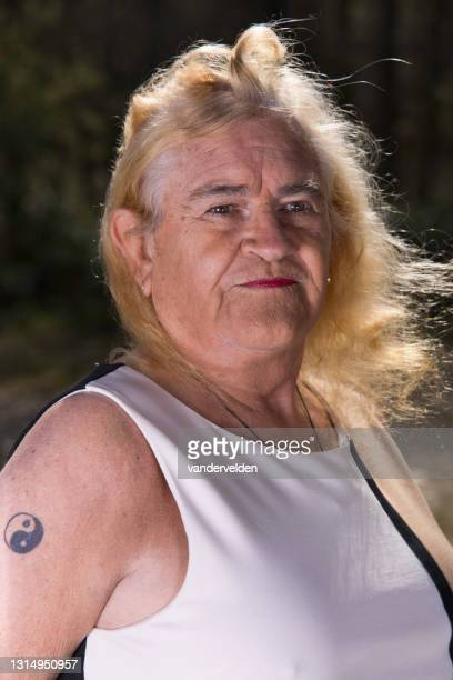 portrait of an elderly transgender person - sleeveless stock pictures, royalty-free photos & images