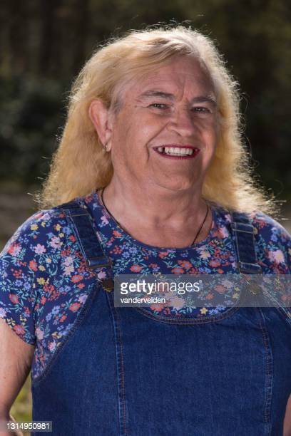 portrait of an elderly transgender person - short sleeved stock pictures, royalty-free photos & images