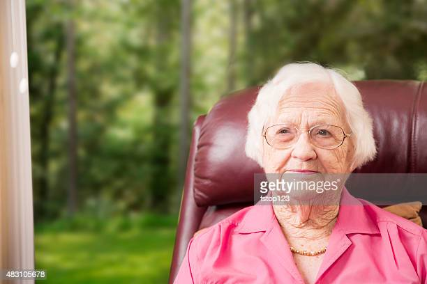 portrait of an elderly woman at home. assisted living. - over 100 stock photos and pictures