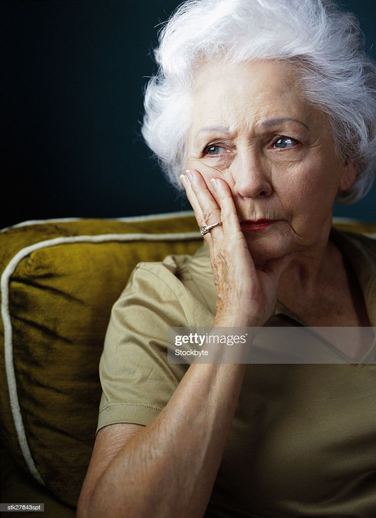 portrait of an elderly woman in a state of worry : Stock Photo