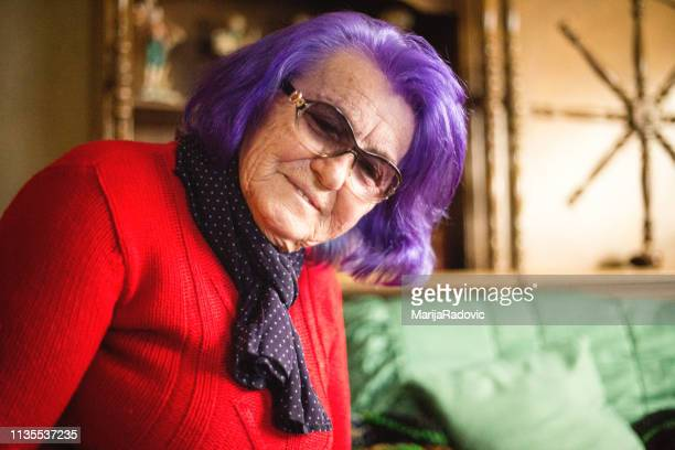 portrait of an elderly woman - purple hair stock pictures, royalty-free photos & images