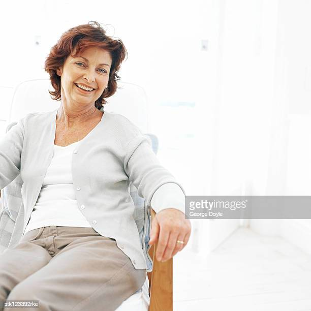 portrait of an elderly woman sitting and smiling