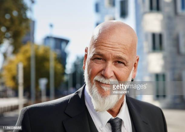 portrait of an elegant businessman in the city - earring stock pictures, royalty-free photos & images
