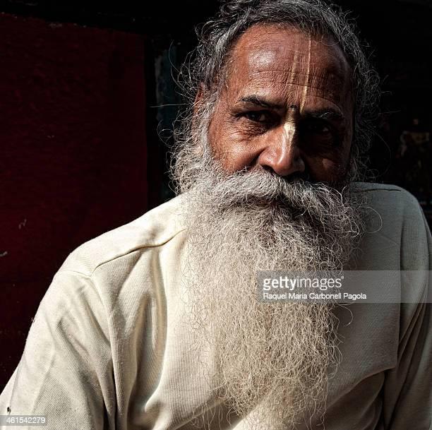 Portrait of an elegant elderly man with a bindi and a big white beard