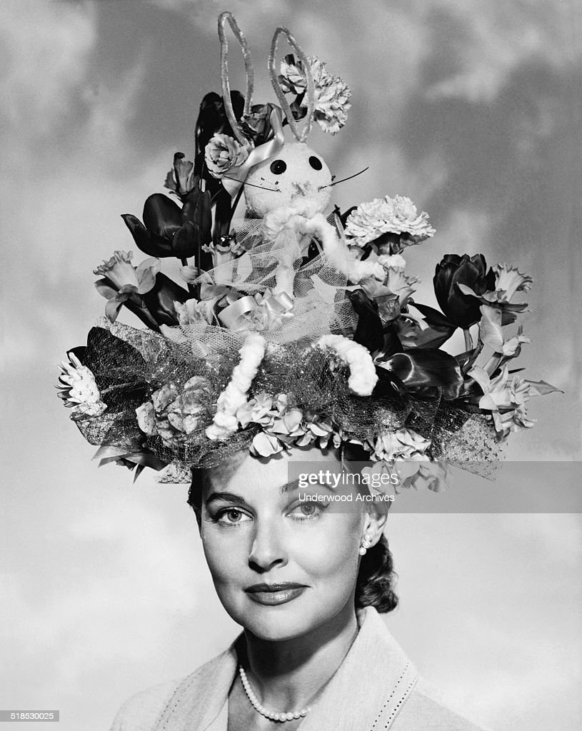 A portrait of an elegant woman wearing a large Easter bonnet, late 1940s or early 1950s.