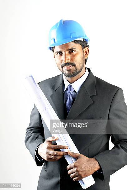Portrait of an engineer with a blueprint